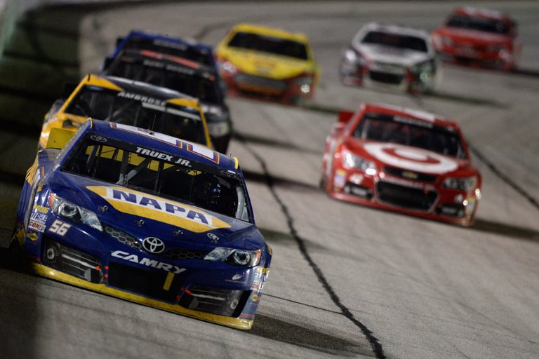 Martin Truex Jr., driver of the #56 NAPA Auto Parts Toyota, leads a pack of cars during the NASCAR Sprint Cup Series AdvoCare 500 at Atlanta Motor Speedway