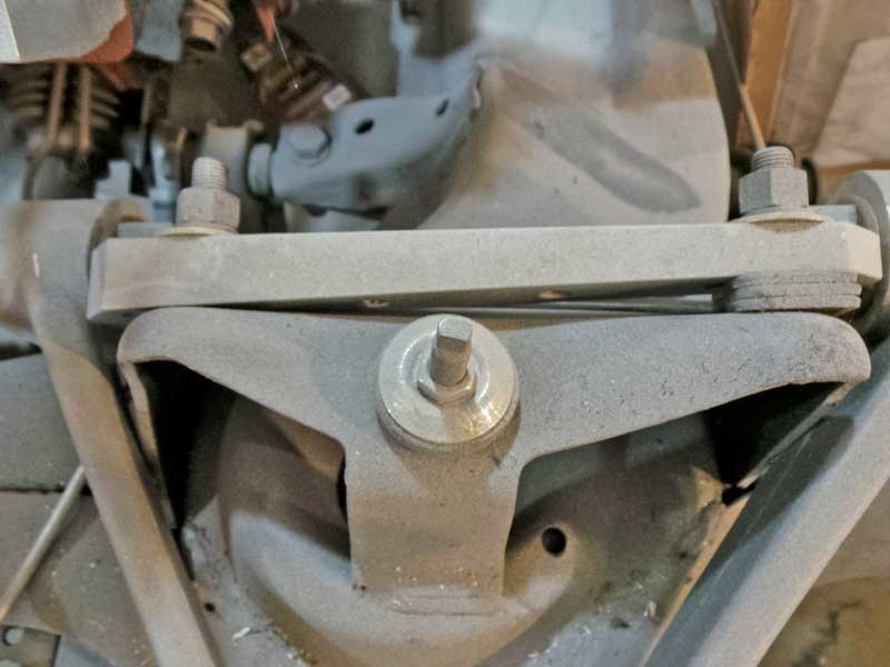 The caster and camber are adjusted with spacers on double-wishbone type suspensions. Strut suspensions have little to no adjustment for caster or camber.