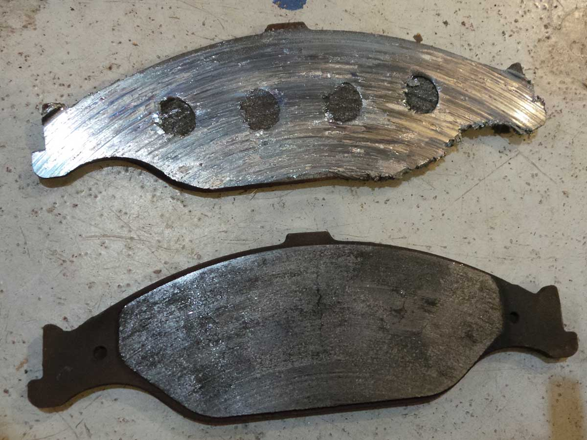 Here are the brake pads from the Mustang rotor shown above. Once the friction material is gone, it is metal on metal.
