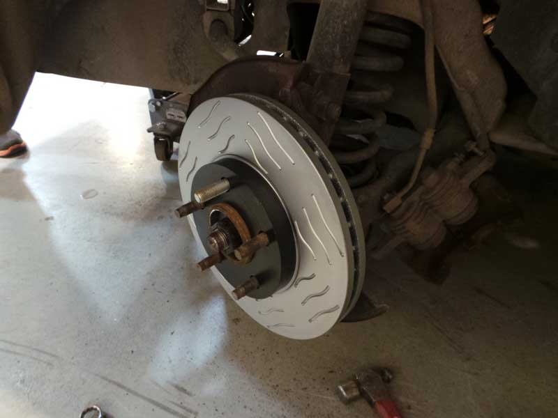 With the new stud in place, the brakes get reinstalled. Now is a great time to service the rest of the braking system, after all, it is already off.
