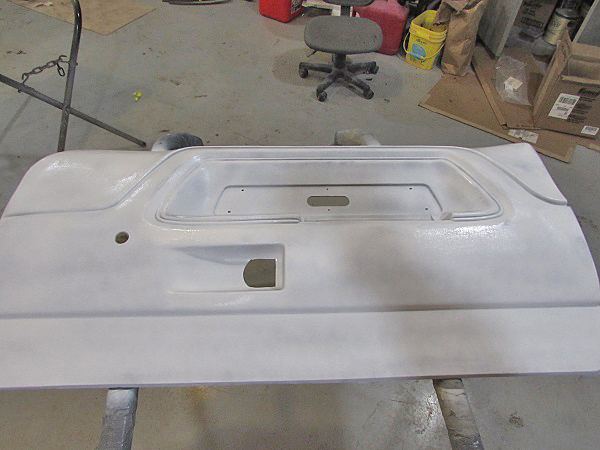 The panel was sprayed with a white guide coat before sanding. This helps us see all the damaged areas.