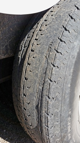 Trailers are notorious for blowing tires. This 10-ply tire was near death after a 5,000 mile cross-country haul.