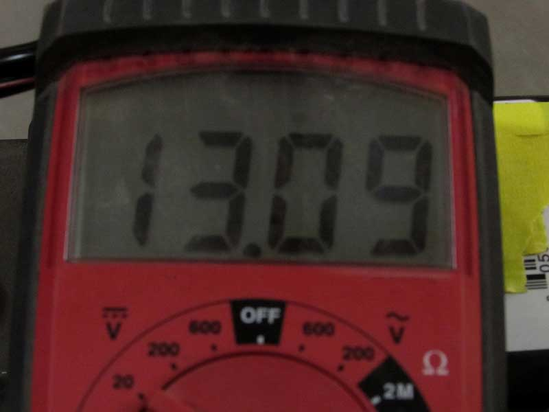The completed battery shows 13.09 volts.