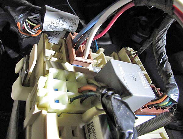 behind the cover is the electrical port block  the harness simply plugs in,  then