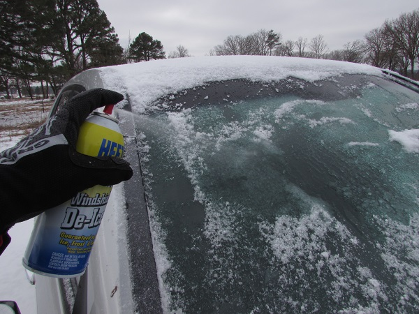 Before applying the scraper, fog down the windshield with liquid deicer.