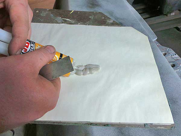 Using a mixing board, a bit of epoxy was pushed out and then mixed up with a spreader.