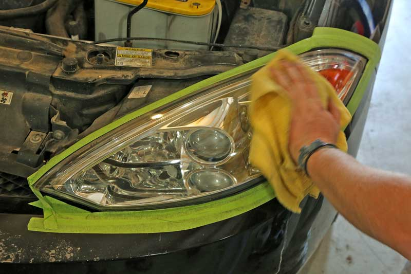 Once that stage is complete, the last headlight restoration step is to apply the wax protectant with a microfiber cloth and then buff it off.