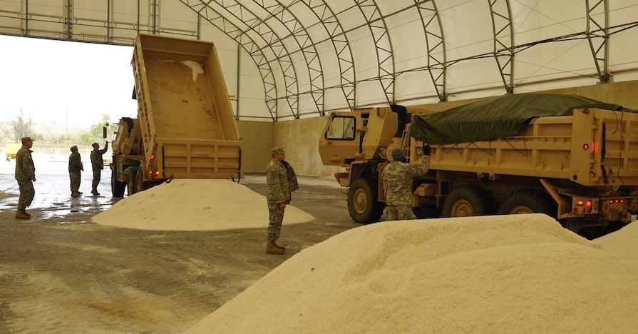 South Carolina National Guard members prepare to transport road salt to affected areas in the Palmetto State.