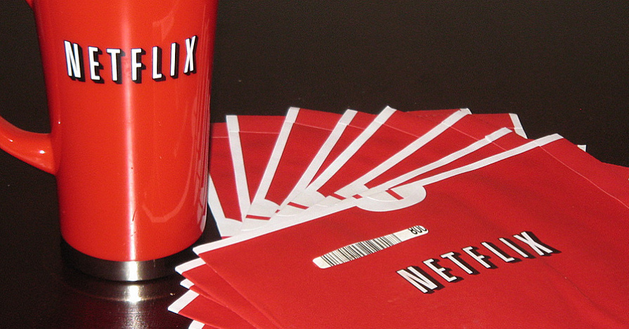 Netflix cup and dvds