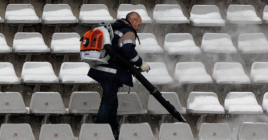 Leaf blower being used to clear snow.