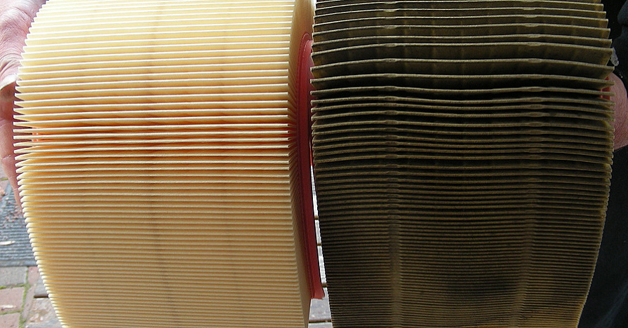A clean cabin air filter compared to a dirty one.