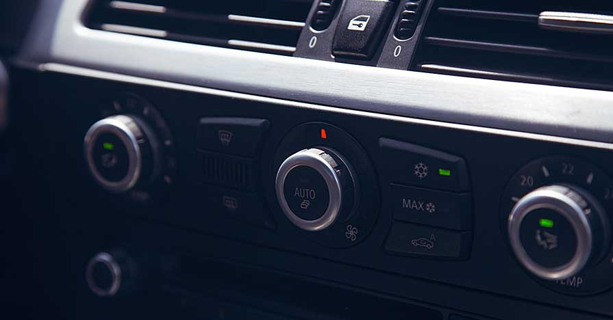 An air vent in a car dashboard.