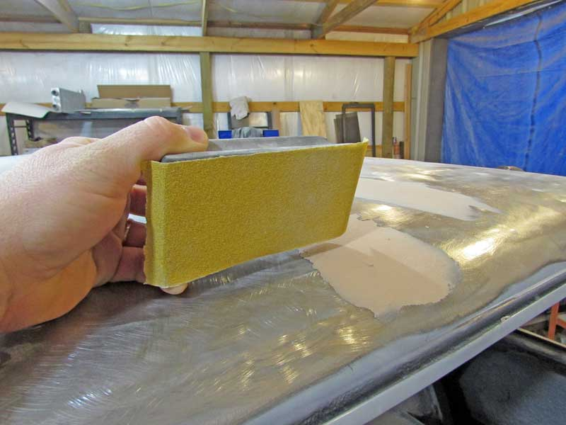 "We started with <a href=""https://www.napaonline.com/p/MMM03076"" target=""_blank"" rel=""noopener noreferrer"">80-grit sand paper</a> on a sanding block. If your plastic body filler is fairly smooth, it should block out pretty fast."