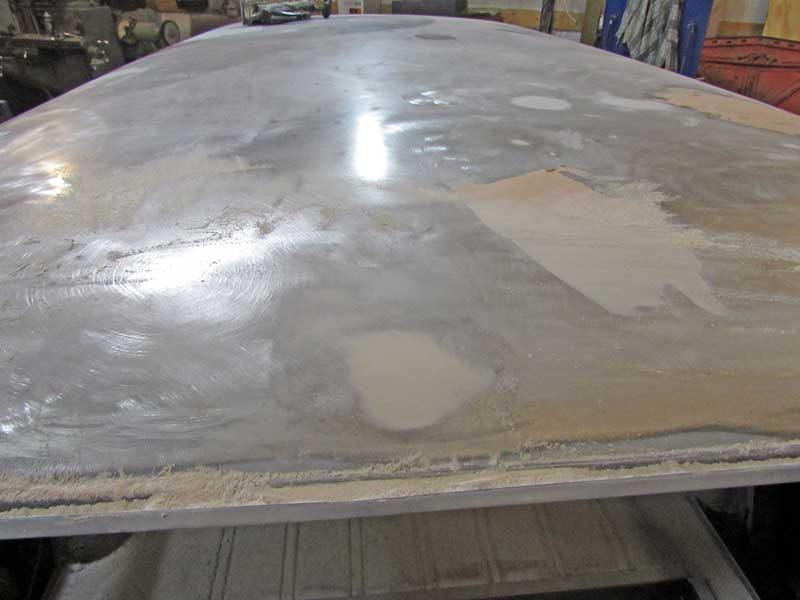Here is the final repair in 80-grit. To finish the job, the filler needs to be sanded with 180-grit, primed, blocked with 300 grit, re-primed, blocked again, and then sealed and painted.