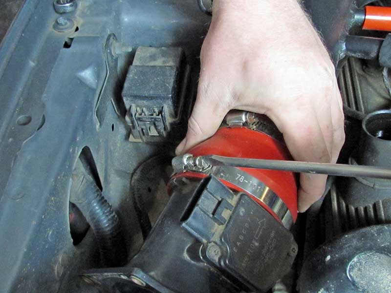 Most sensors are connected with hose clamps. Loosen the clamp and remove the sensor box.