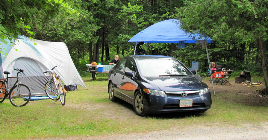 Car parked at campsite.