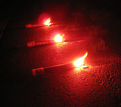 Flares or reflective triangles can warn motorists of your breakdown and summon help.