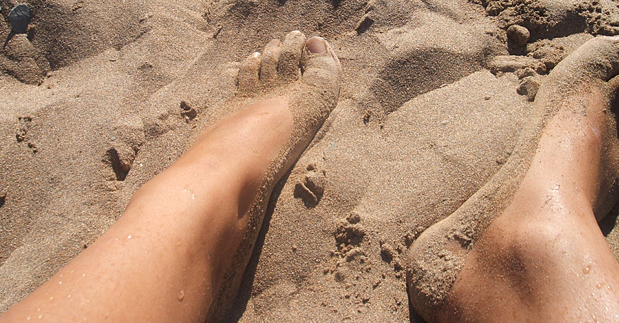 Sandy feet at the beach.