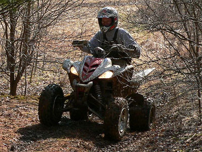 Riding an ATV in the woods