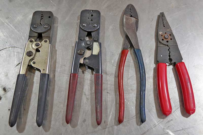 Assorted hand tools for wiring are critical to getting the job done right. From the left- Metri-pack/Weather-pack crimpers (2 sets), insulated and non-insulated crimpers, multi-use tool