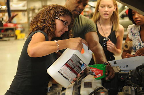 Students learn how to mix antifreeze before pouring it into the radiator.