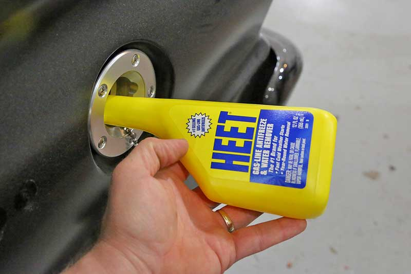 Literally as simple and pouring it into the gas tank. This will remove water, keeping your car on the road.