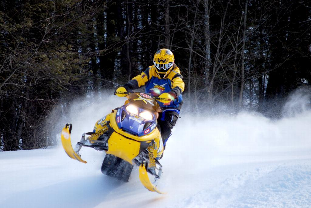 Riding snowmobile aggressively