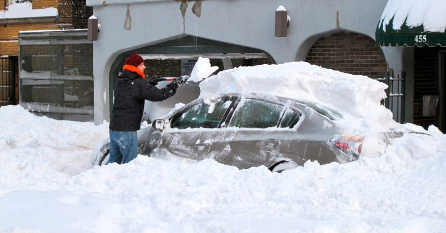 Car being cleared in deep snow