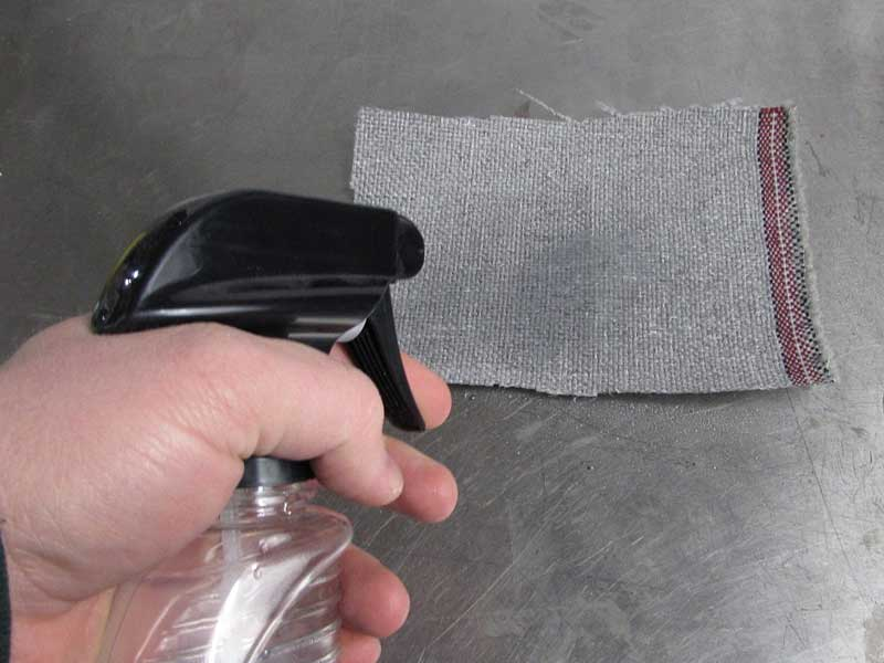 We sprayed water on the swatch and you can instantly see how fast the untreated side soaked up the water.