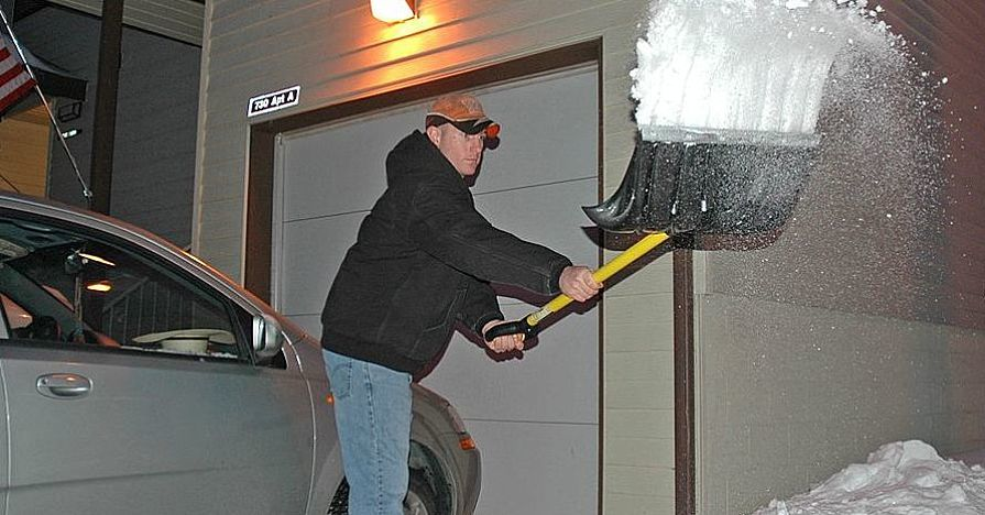 Shoveling snow with the right shovel can help avert back problems