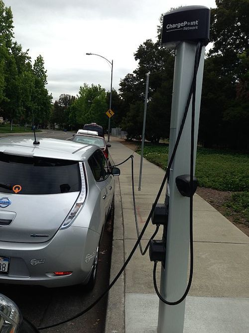 Nissan Leaf being charged at a ChargePoint electric car charging station