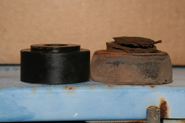 On the left- new replacement polyurethane bushing. On the right- factory rubber bushing.