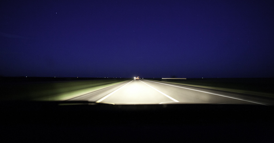 Headlights on the road at night