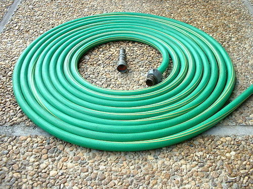 Garden hose with a nozzle.