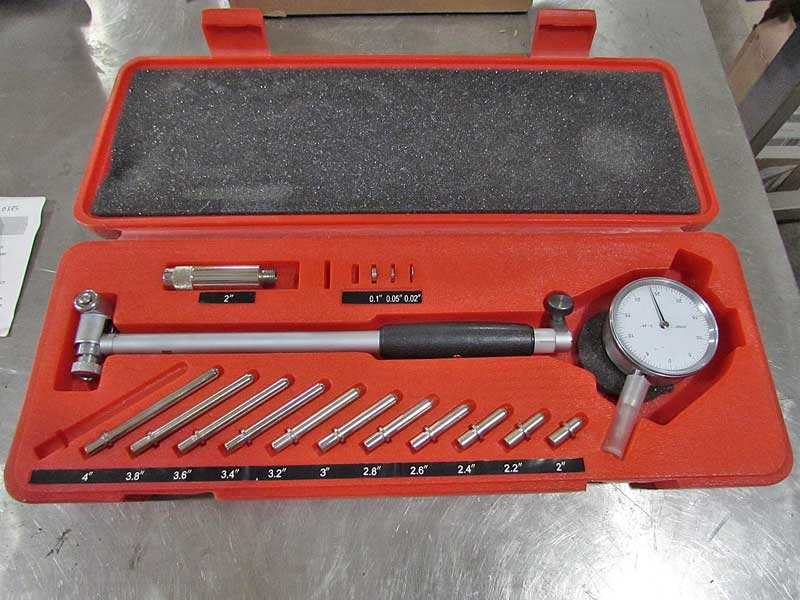 The dial bore gauge measures the inside of round holes, such as the bearing journals.