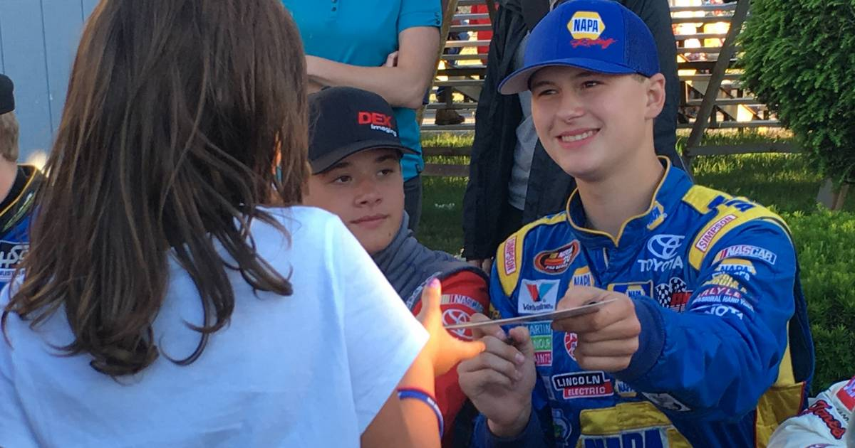 Todd Gilliland meeting young fans autograph