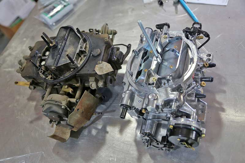 The stock 4-barrel carburetor on the left is from a 1965 Mercury 390. It functions, but several plastic linkages are broken and replacement is easier than sourcing hard to find parts.