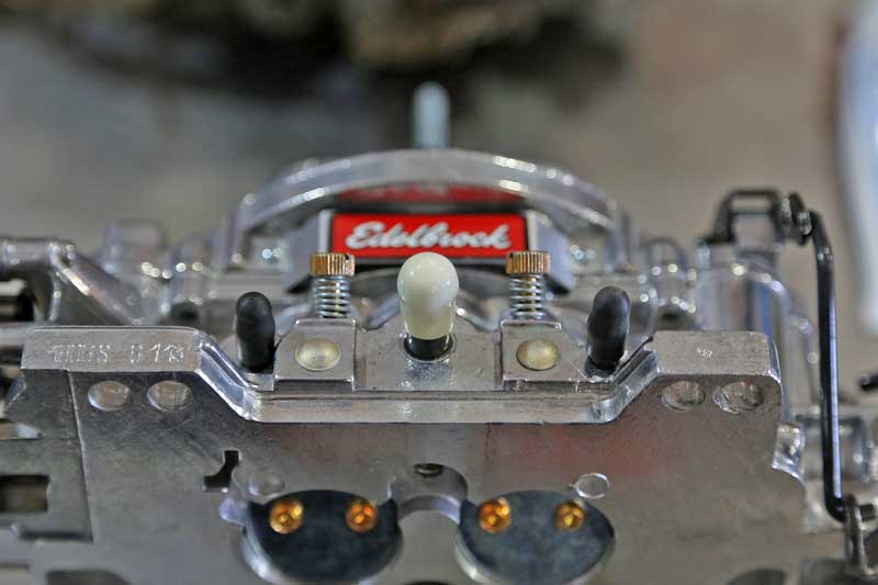 On the front side of the carburetor are the primary idle mixture screws, along with some vacuum ports.