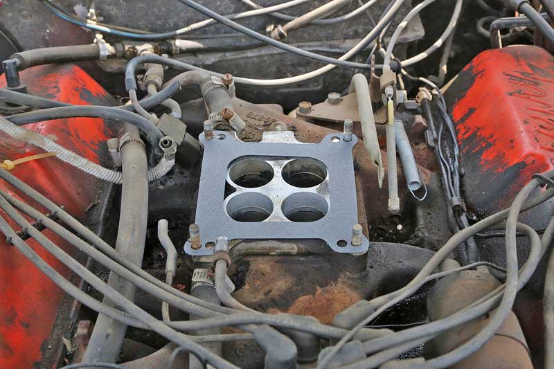 Any time the carburetor comes off, you must replace the gasket. If you don't, there will be an air leak.