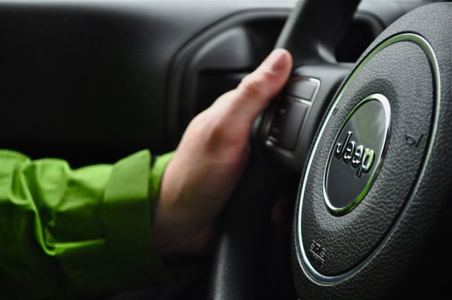 Car horn on steering wheel.
