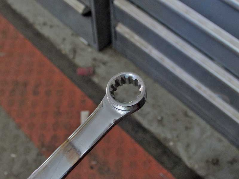 Specialty wrenches like this one from Gearwrench are designed to catch on rounded corners.