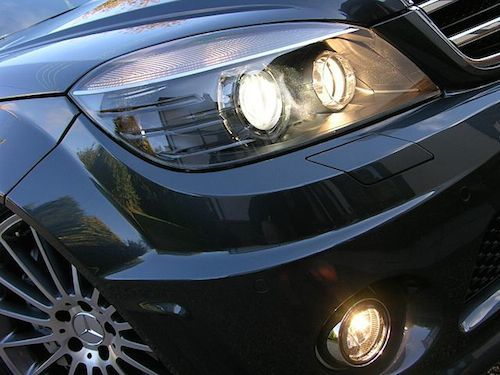 Headlights and fog lights activated on a Mercedes-Benz.