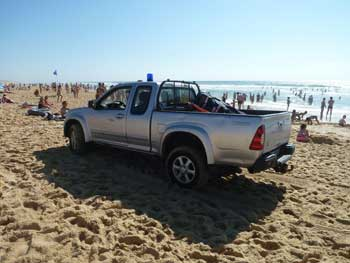 Pickup truck on beach
