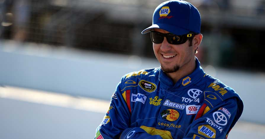 LOUDON, NH - SEPTEMBER 20: Martin Truex Jr., driver of the #56 NAPA Auto Parts Toyota, stands on the grid during qualifying for the NASCAR Sprint Cup Series Sylvania 300 at New Hampshire Motor Speedway on September 20, 2013 in Loudon, New Hampshire. (Photo by Patrick Smith/Getty Images)