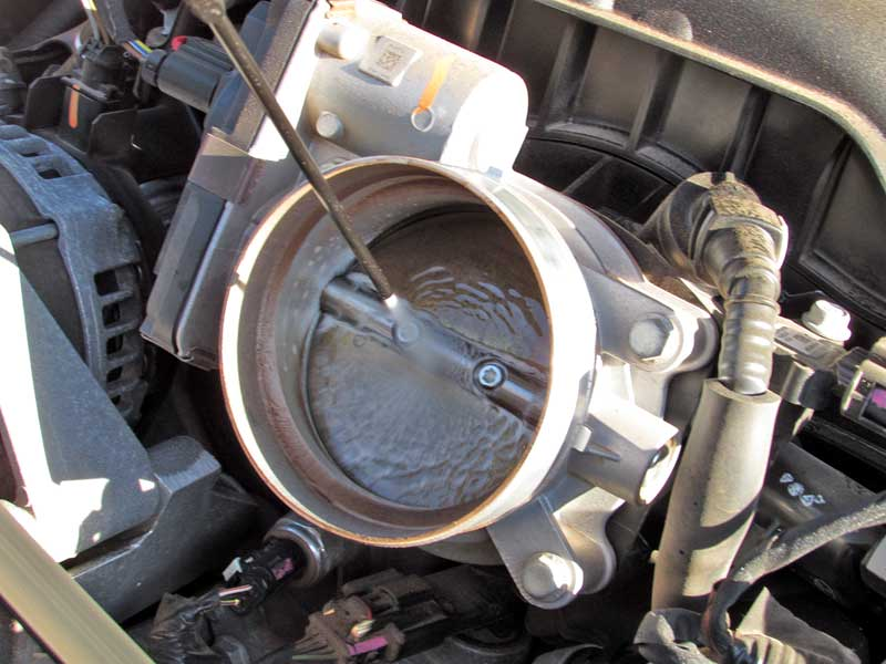 Spray CRC GDI IVD® Intake Valve & Turbo Cleaner directly into the throttle body in short bursts.