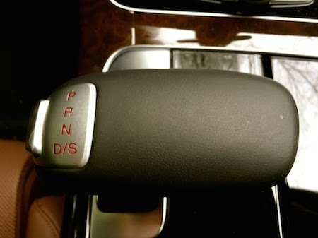 A gear shift lever with the shift pattern on top.