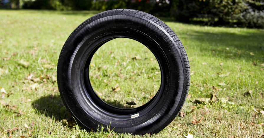 tire standing on grass