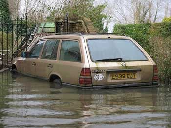 a car submerged in flood waters