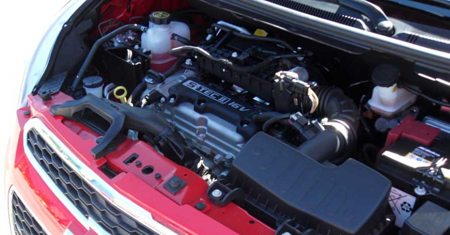 An engine under the hood of a new car prepared for the engine break-in process.