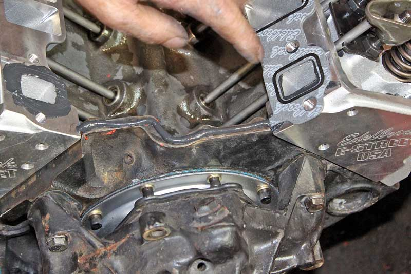 The beauty of silicone is that it can take the place of a gasket altogether. Here is a small block Chevy intake, the factory cork gaskets on the ends tend to push out and leak, so it is common to leave them out and just use a bead of silicone instead.